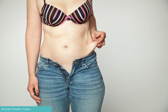 Frau mit Fettschürze